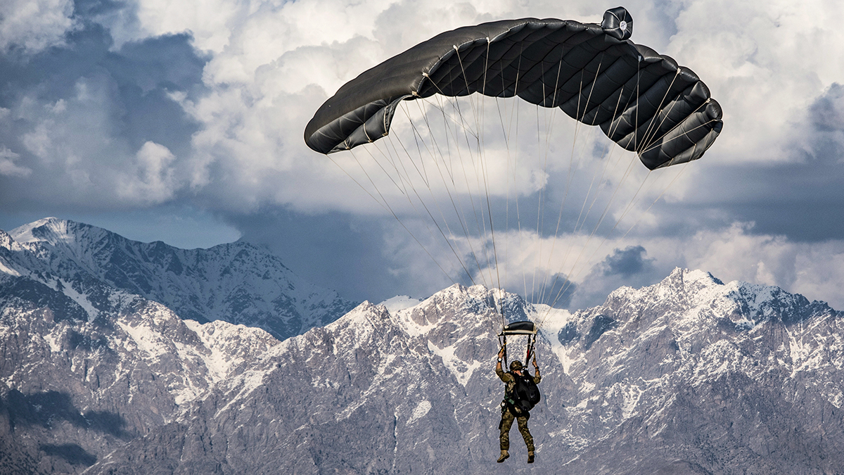 A U.S. Air Force pararescueman assigned to the 83rd Expeditionary Rescue Squadron, Bagram Airfield, Afghanistan, operates the canopy of his parachute while conducting a high altitude, high opening military free fall jump working with a C-130J Super Hercules flown by the 774th Expeditionary Airlift Squadron, Bagram Airfield, Afghanistan, March 4, 2018. Guardian Angel Team members conduct training on all aspects of combat, medical procedures and search and rescue tactics to hone their skills, providing the highest level of tactical capabilities to combatant commanders. (Tech. Sgt. Gregory Brook/Air Force)