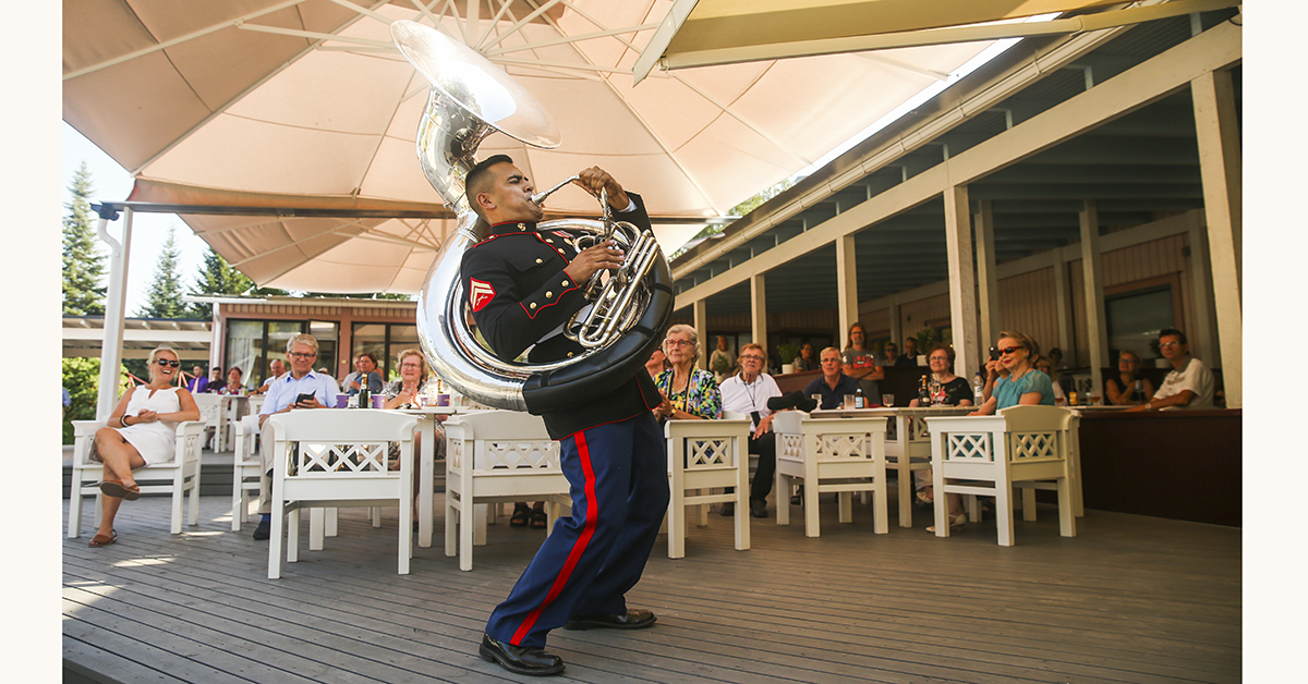 Cpl. Rafael J. Marin, musician, Marine Corps Base Quantico (MCBQ) Band, performs during a concert at Kesaheina, Mantyharju, Finland, July 29, 2018. The band continues to perform at different locations around Finland as they prepare for the 2018 Hamina Tattoo. (Cpl. Cristian L. Ricardo/Marines)