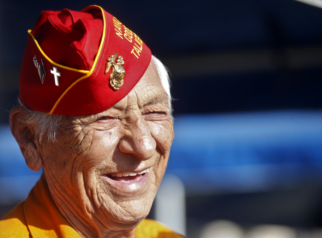 In this Sept. 28, 2015, file photo, former Marine and Navajo Code Talker Roy Hawthorne Sr. listens during a ceremony honoring the code talkers' contribution to the U.S. effort during World War II at Camp Pendleton, Calif. The Navajo Nation says Hawthorne Sr. died Saturday, April 21, 2018. He was 92. (Lenny Ignelzi/AP)