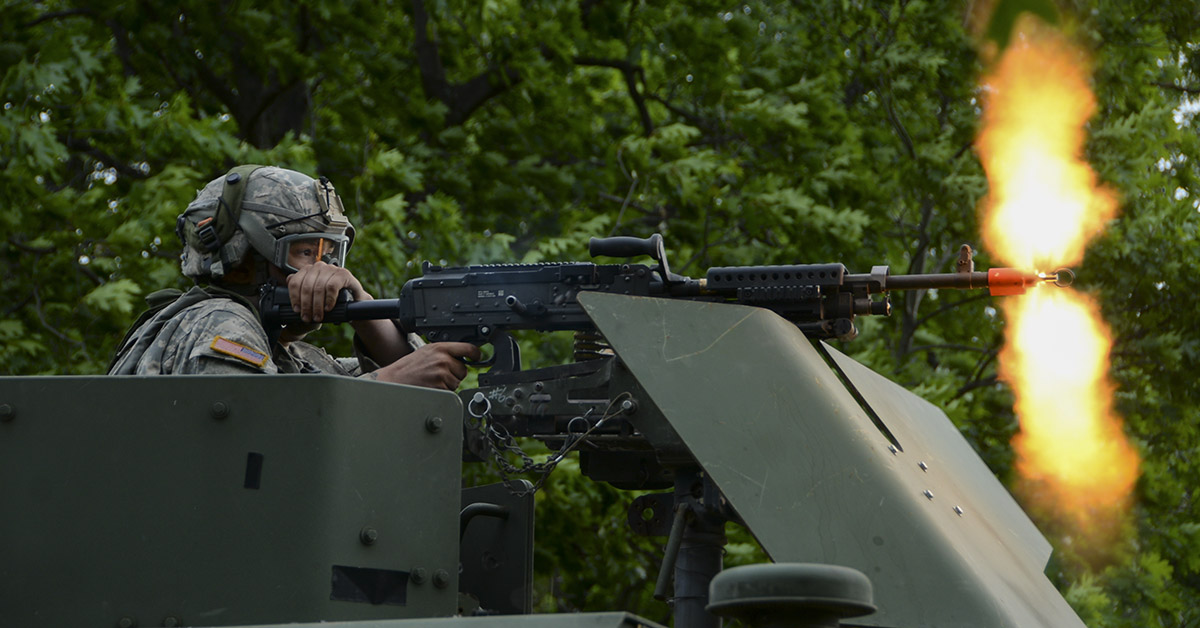 Pvt. Anthony Balac, assigned to the 2nd Platoon, 206th Military Police Company, New York Army National Guard, fires an M240B machine gun June 14, 2018, at Fort Drum, New York. Balac and his team came under simulated fire while providing support for Soldiers of 3rd Platoon who were conducting base security training. (Spc. Andrew Valenza/Army National Guard)