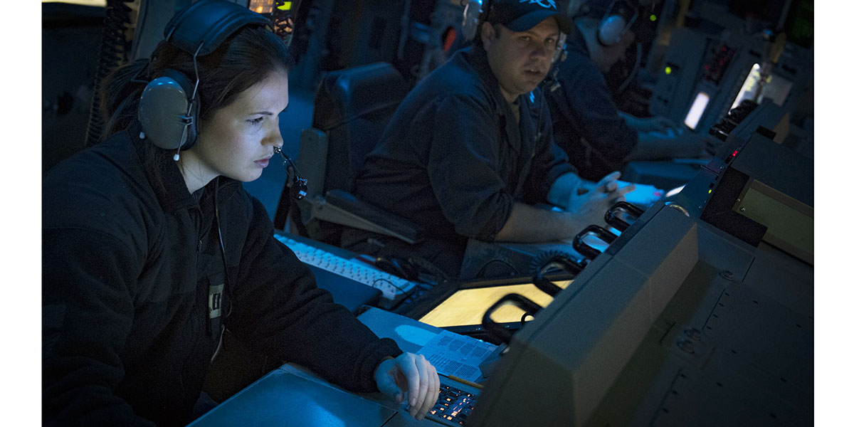 Lt. Cassidy Simmonds, left, and Lt. Joshua Mills stand watch in the combat information center aboard the guided-missile destroyer Donald Cook as the ship participates in maritime interoperability training with the Turkish navy Yavuz-class frigate TS Fatih, Feb. 22, in the Black Sea. (Mass Communication Specialist 2nd Class Ford Williams/Navy)
