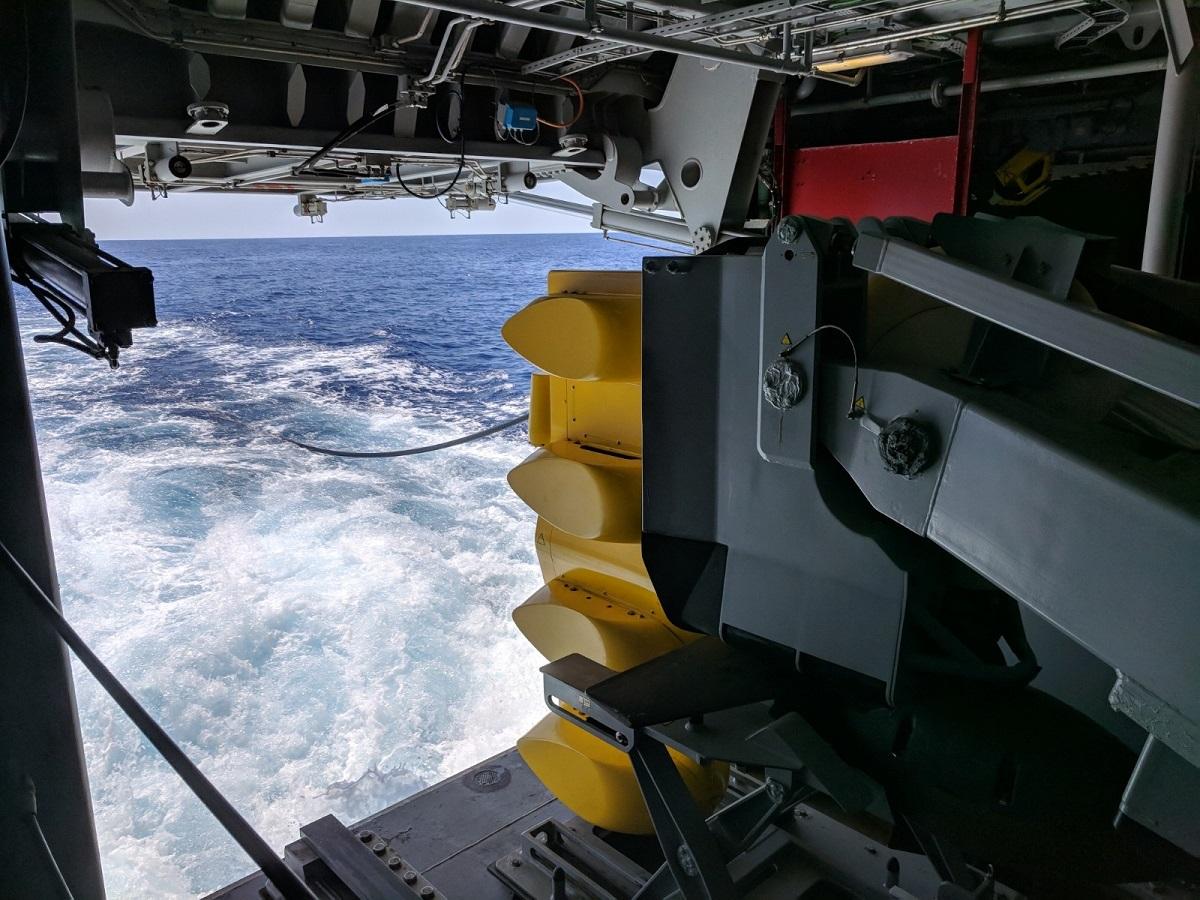 The Italian FREMM Alpino prepares to deploy its variable-depth sonar. (David B. Larter/Staff)