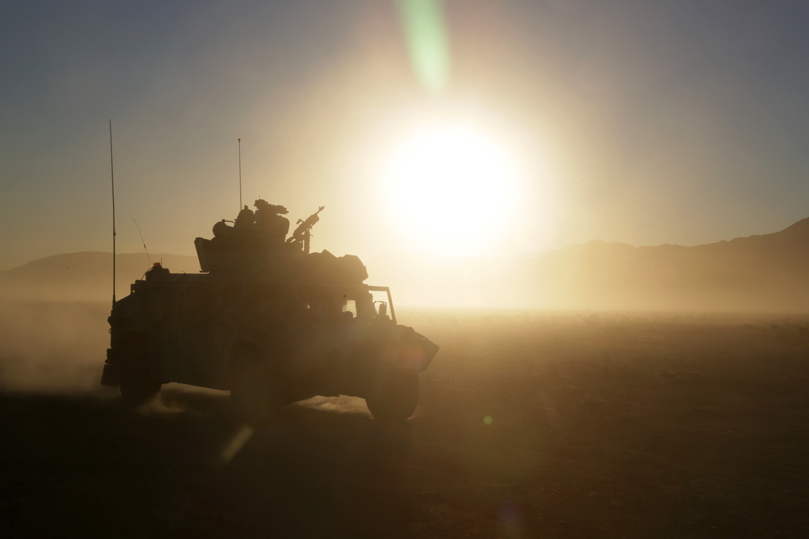 Soldiers assigned to 1st Squadron, 11th Armored Cavalry Regiment, assault an objective during Decisive Action Rotation 18-02 at the National Training Center in Fort Irwin, Calif. (Spc. Daniel Parrott/Army)