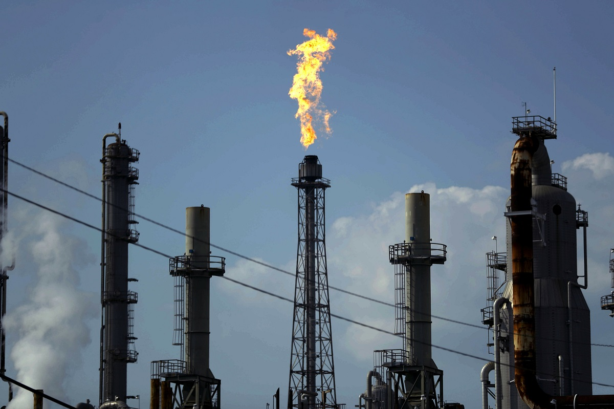 In this Thursday, Aug. 31, 2017, photo, a flame burns at the Shell Deer Park oil refinery in Deer Park, Texas. Iran has increased its offensive cyberattacks against the U.S. government and critical infrastructure as tensions have grown between the two nations, cybersecurity firms say. In recent weeks, hackers believed to be working for the Iranian government have targeted U.S. government agencies, as well as sectors of the economy, including oil and gas, sending waves of spear-phishing emails, according to representatives of cybersecurity companies CrowdStrike and FireEye, which regularly track such activity. (Gregory Bull/AP)