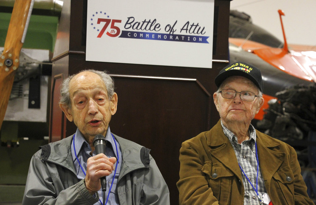 In this May 19, 2018, photo World War II veterans Allan Seroll, left, of Massachusetts, and William Roy Dover, right, of Alabama, right, attend a 75th anniversary celebration of the Battle of Attu in Anchorage, Alaska. Dover was an American soldier who took part in the May 1943 effort to reclaim Alaska's Attu Island from the Japanese. It was the only World War II battle fought on North American soil. (Mark Thiessen/AP)