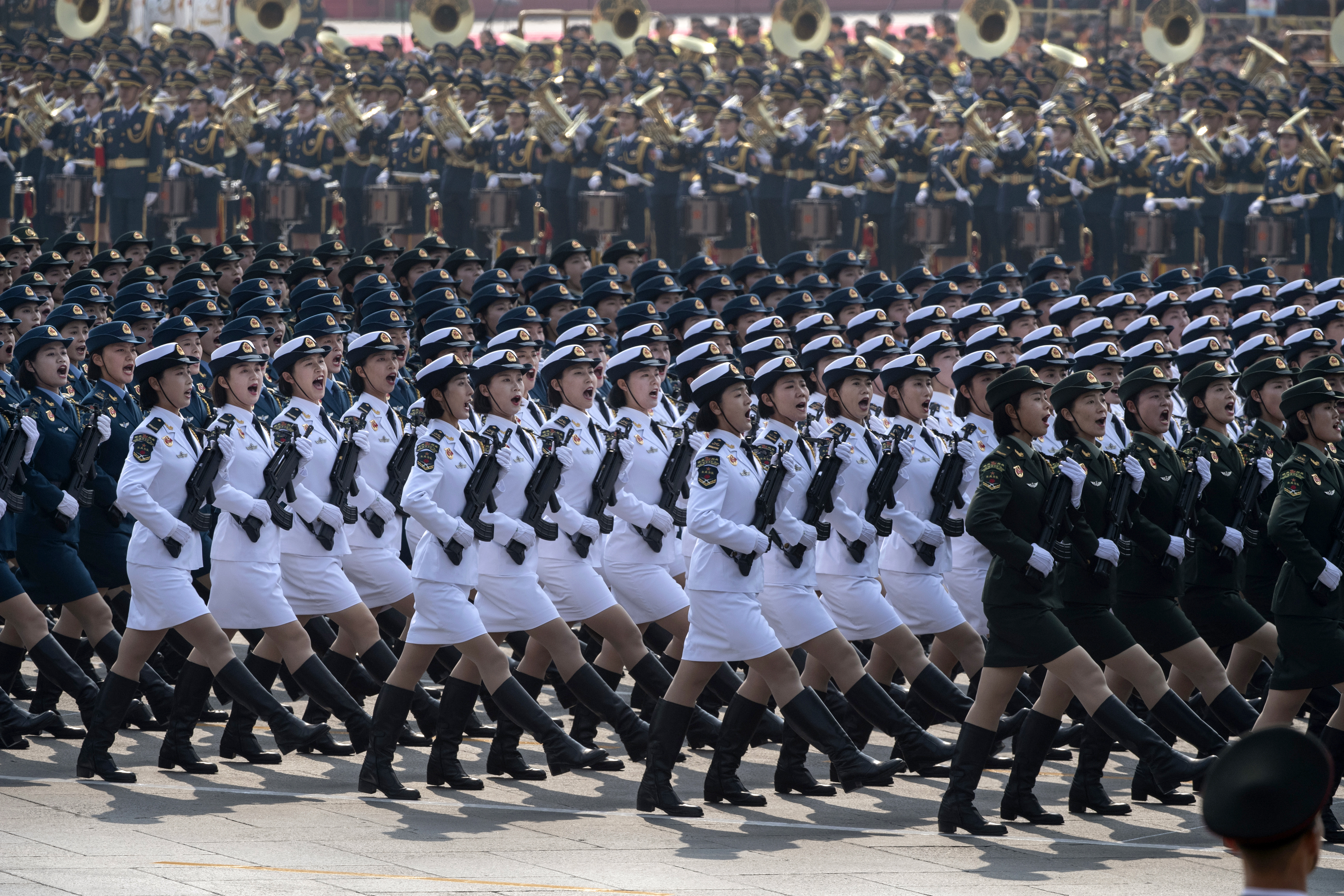 Chinese soldiers shout as they march in formation. (Kevin Frayer/Getty Images)