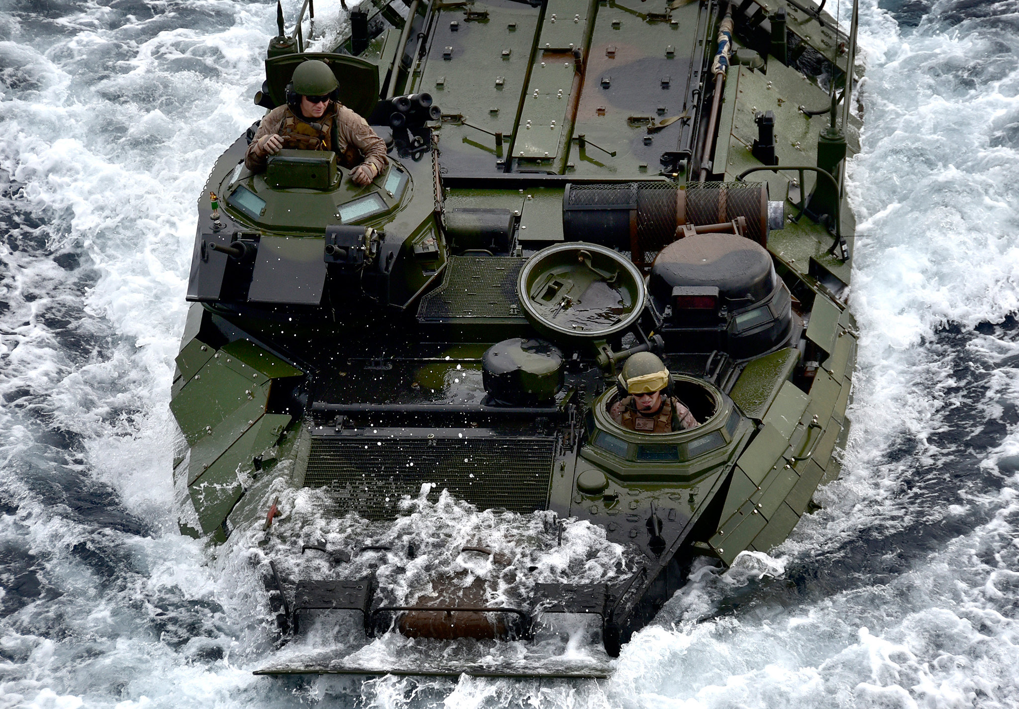 A Marine Corps assault amphibious vehicle enters the well deck of the amphibious assault ship USS Wasp (LHD 1) on March 25, 2019, in the Philippine Sea. (Mass Communication Specialist 1st Class Daniel Barker/Navy)