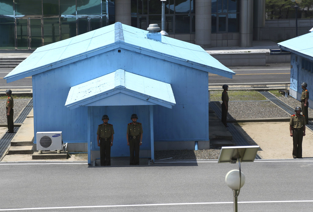 North Korean soldiers stand guard at the truce village at the Demilitarized Zone (DMZ) which separates the two Koreas in Panmunjom, North Korea, Wednesday, June 20, 2018. (Dita Alangkara/AP)