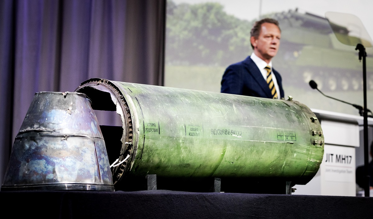 Head prosecutor Fred Westerbeke speaks next to a part of the Buk rocket that was allegedly fired on Malaysian Airlines Flight MH17 during a news conference of the Joint Investigation Team in Bunnik, the Netherlands, on May 24, 2018. (Robin van Lonkhuijsen/AFP via Getty Images)