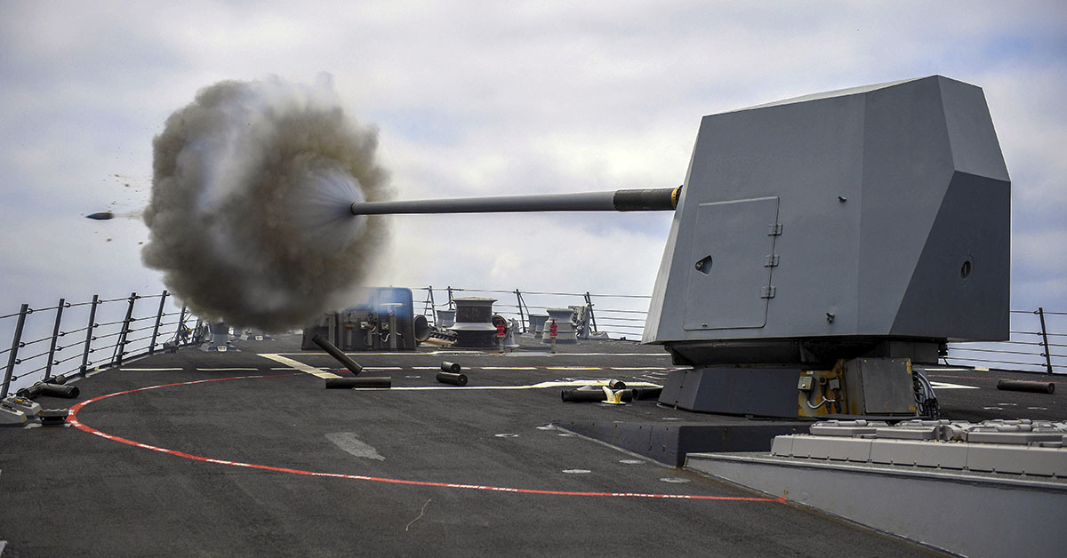 The Arleigh Burke-class guided-missile destroyer USS Bainbridge (DDG 96) fires its Mark 45 five-inch gun during a live-fire exercise. Bainbridge, homeported at Naval Station Norfolk, is conducting naval operations in the U.S. 6th Fleet area of operations in support of U.S. national security interests in Europe and Africa. (MC1 Theron J. Godbold/Navy)