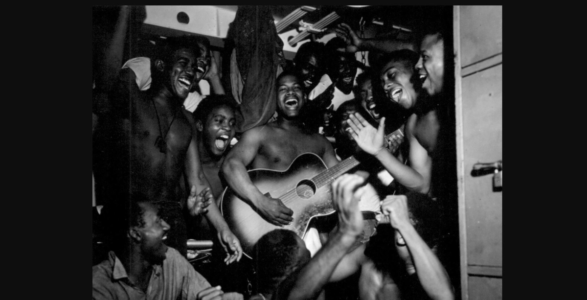 Enlisted men aboard the aircraaft carrier Ticonderoga hear the news of Japan's surrender on Aug. 14, 1945. (Lt. B. Gallagher, now in the collections of the National Archives)