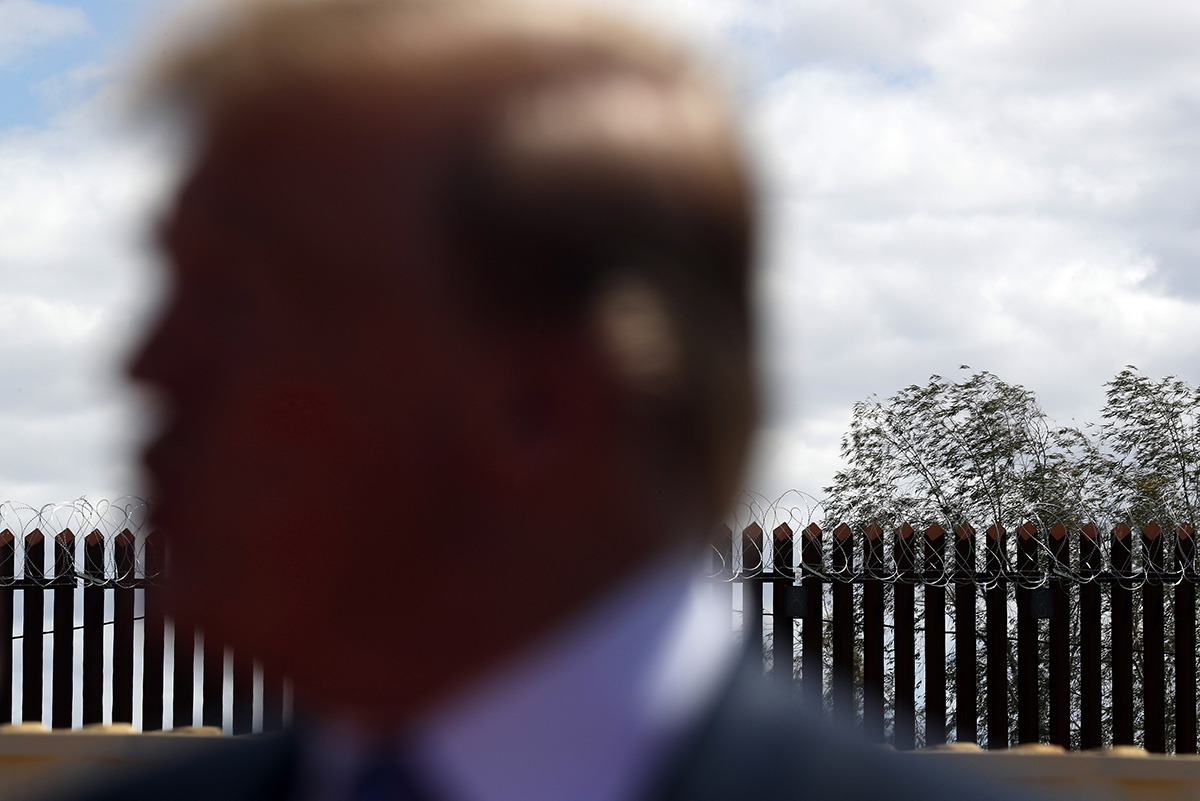 In this April 5, 2019, file photo, President Donald Trump speaks as he visits a new section of the border wall with Mexico in Calexico, Calif. (Jacquelyn Martin/AP)