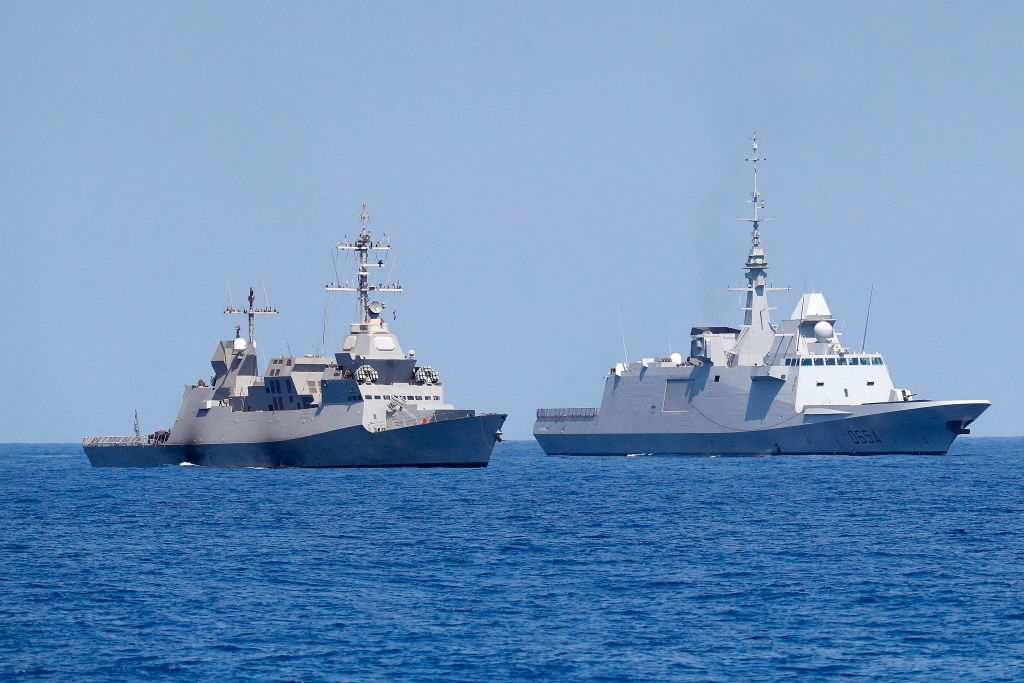 A photo taken on August 7, 2019, shows an Israeli Sa'ar 5 class corvette (L) and the French anti-submarine frigate FREMM Auvergne (R) during an exercise how simulate a humanitarian response to a powerful earthquake and significant movement of IDF vessels and foreign vessels in the Mediterranean sea. (JACK GUEZ/AFP/Getty Images)