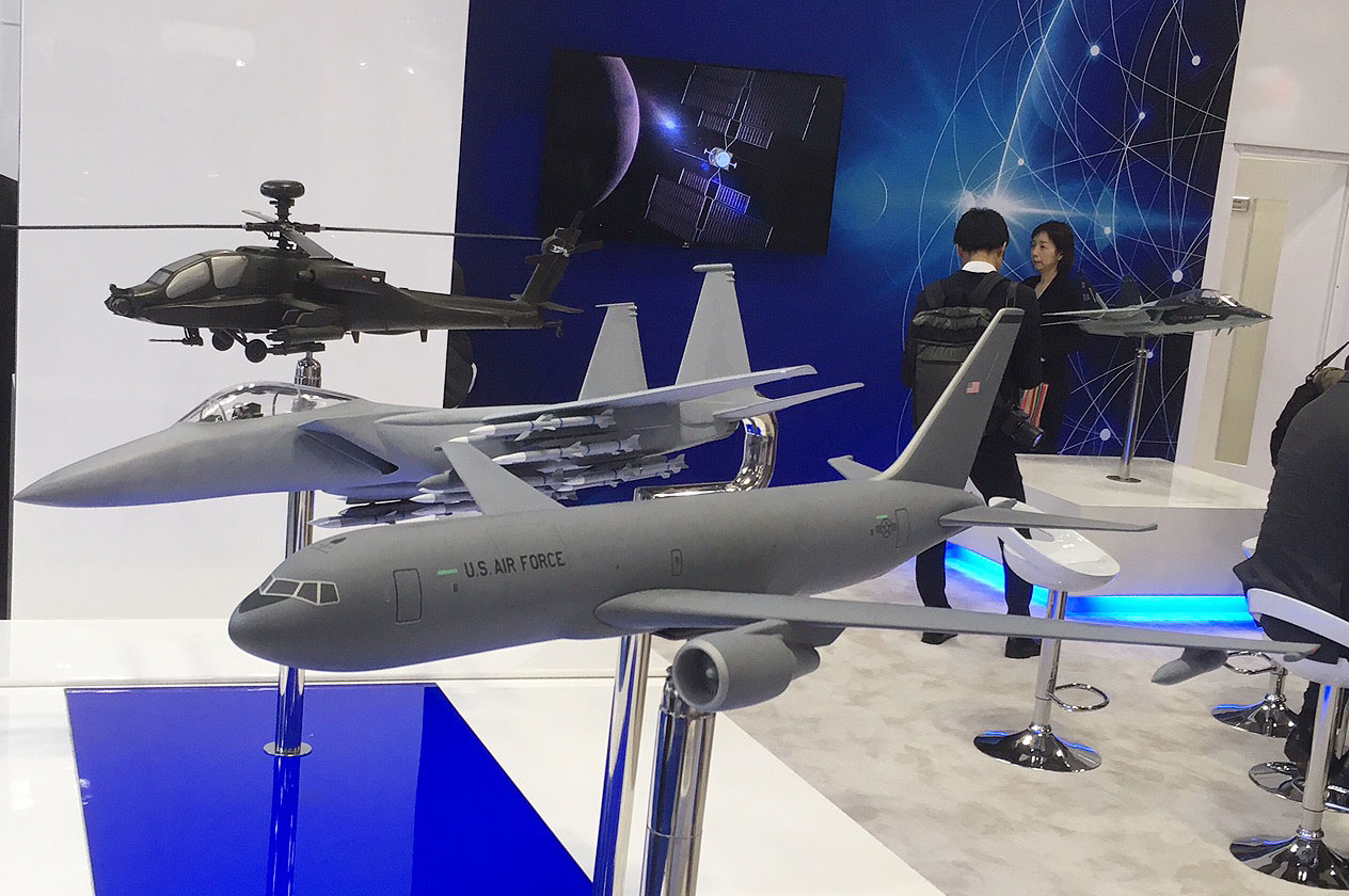 Boeing's presence at the Japan International Aerospace Exhibition mainly consisted of civilian and commercial aircraft, although it displayed models of its KC-46A tanker, F-15 Advanced Eagle and AH-64E Apache helicopter gunship. Japan has already selected the KC-46 for its next tanker, having been cleared to buy four aircraft in 2016 and awarding a contract for one of them in late 2017. (Mike Yeo/Staff)