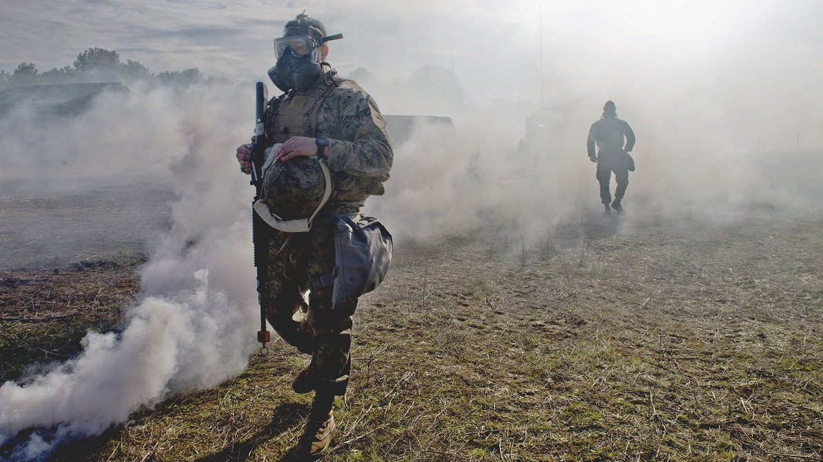 Marines with Special-Purpose Marine Air-Ground Task Force-Crisis Response-Africa, logistics combat element, simulate a gas attack during a field exercise at Morón Air Base, Spain, Feb. 7. (Sgt. Takoune H. Norasingh/Marine Corps)