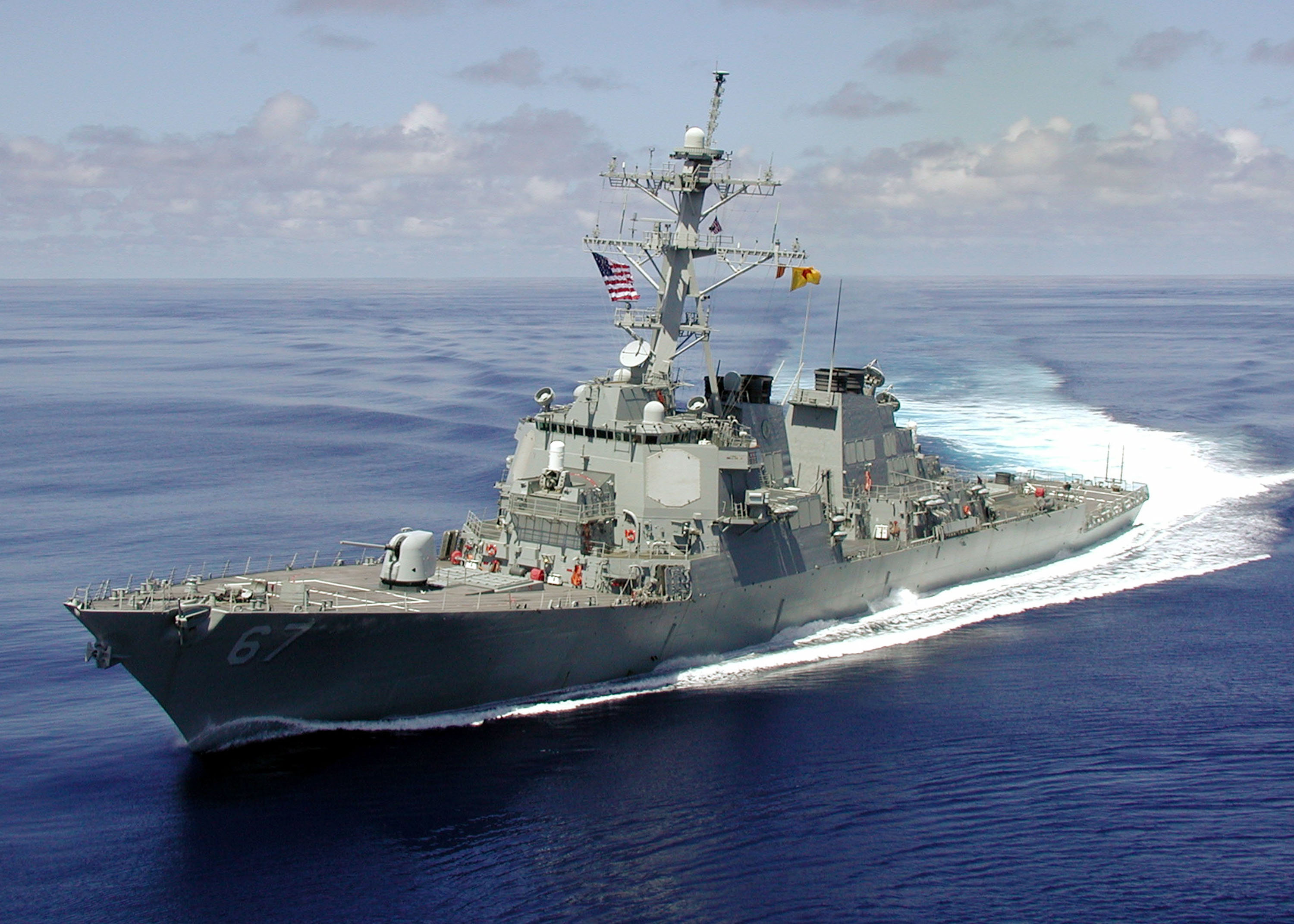 The Arleigh Burke class guided missile destroyer USS Cole is shown at sea approximately one month before being attacked by a terrorist-suicide mission which killed 17 U.S. sailors and injured approximately 36 others during a refueling operation October 12, 2000 in the port of Aden, Yemen. Al-Qaeda's chief of Persian Gulf operations, Abd al-Rahim al-Nashiri, also known as