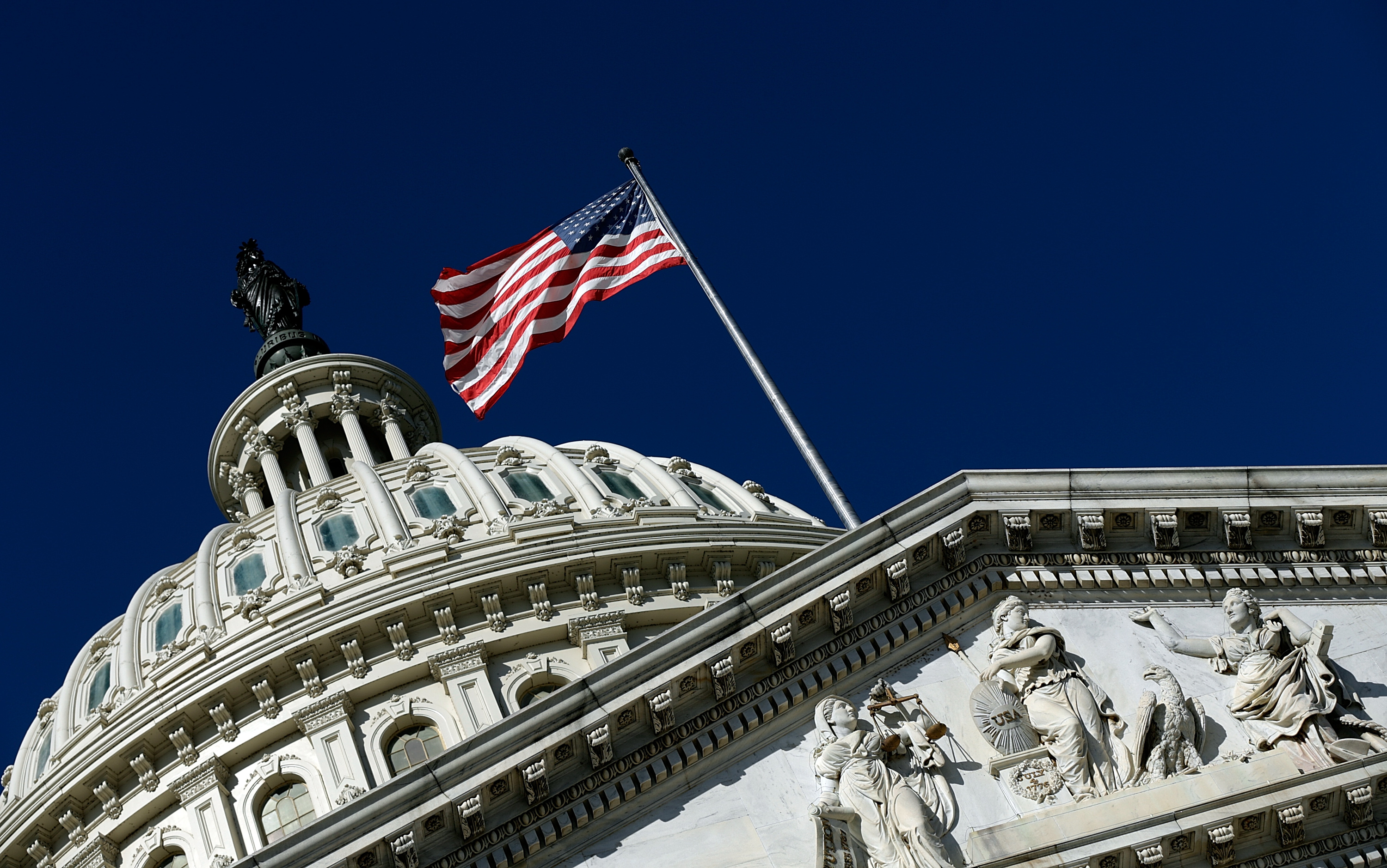An American flag waves outside the United States Capitol building as Congress. (Win McNamee/Getty Images)