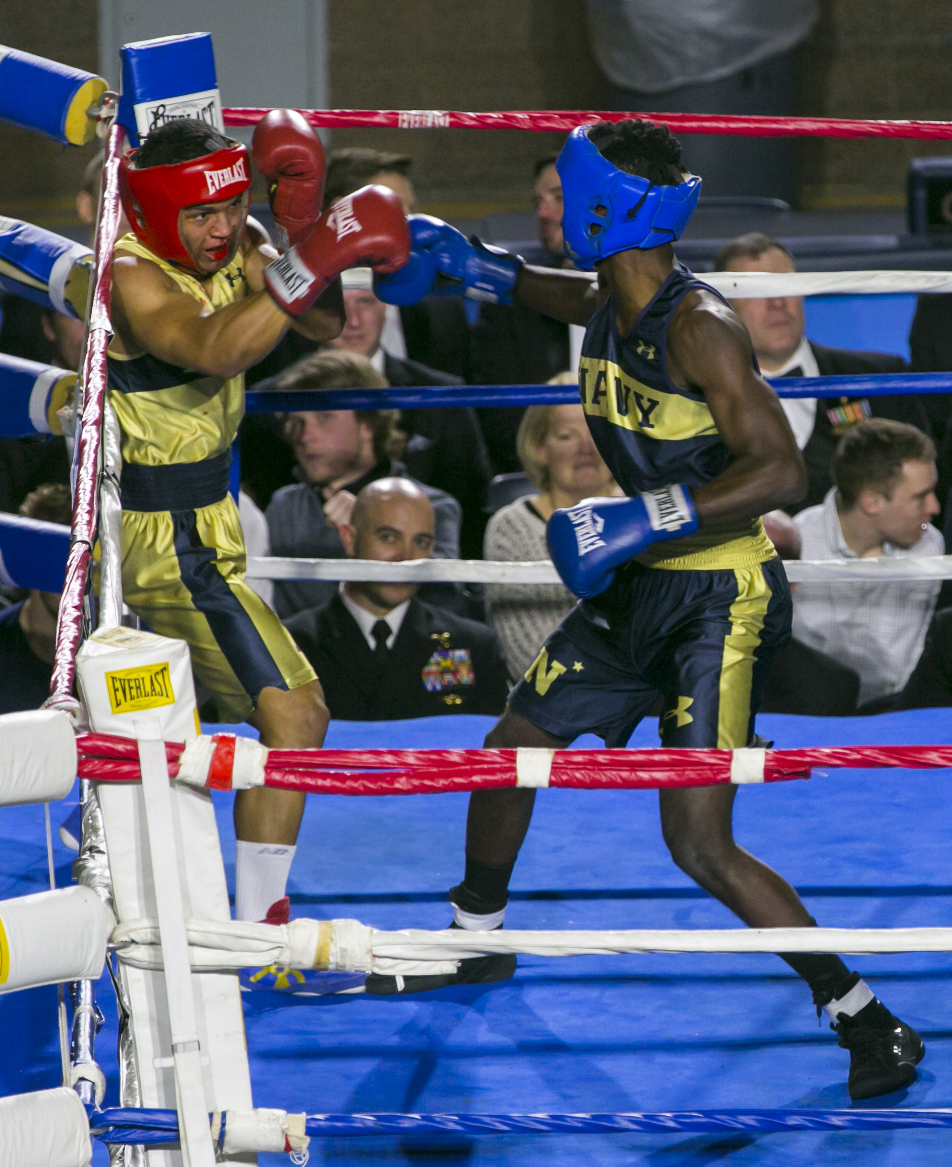 Kendell Louis (in blue) from Miami, FL backs Jordon McDaniel (in gold) from East Chicago, IN into the corner during the 147-lb weight class fight at the United States Naval Academy's 77th Brigade Boxing Championships held on Feb. 23, 2018. Louis won the bout. (Alan Lessig/Staff)