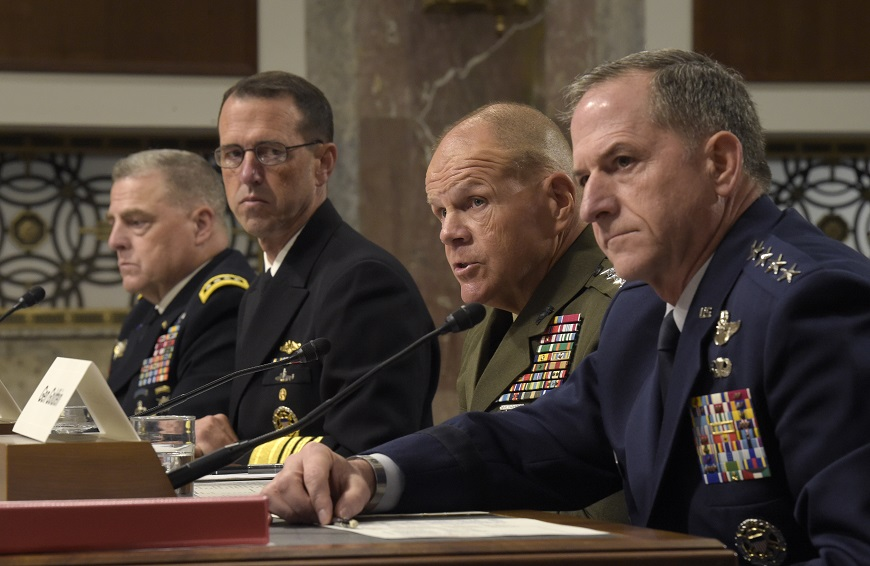 The U.S. military service chiefs, from left, Army Chief of Staff Gen. Mark Milley, Chief of Naval Operations Adm. John Richardson, Marine Corps Commandant Gen. Robert B. Neller and Air Force Chief of Staff Gen. David Goldfein, are shown last year. In recent days they have all publicly denounced racism and extremism after a white supremacist rally in Virginia. (Susan Walsh/AP)
