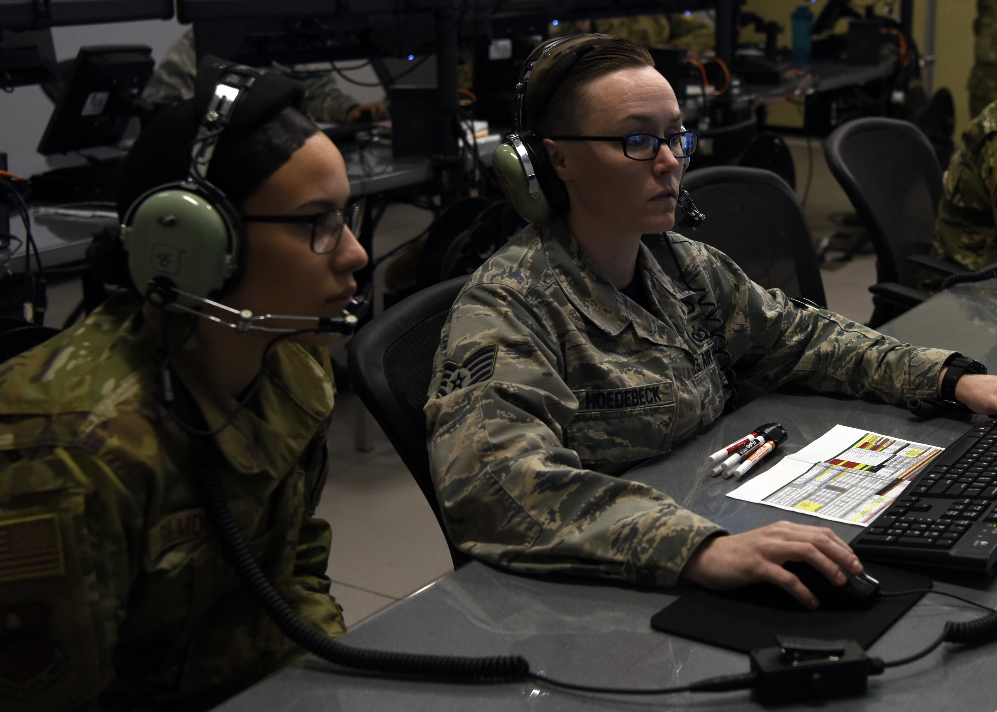 Staff Sgt. Amber Hoedebeck, right, controls an air fight as Airman Jaeda Gilmore simulates friendly fire during the first all-female Command and Control Battle Management Operations team mission on March 22, 2019, at Luke Air Force Base, Ariz. (Airman 1st Class Zoie Cox/U.S. Air Force)
