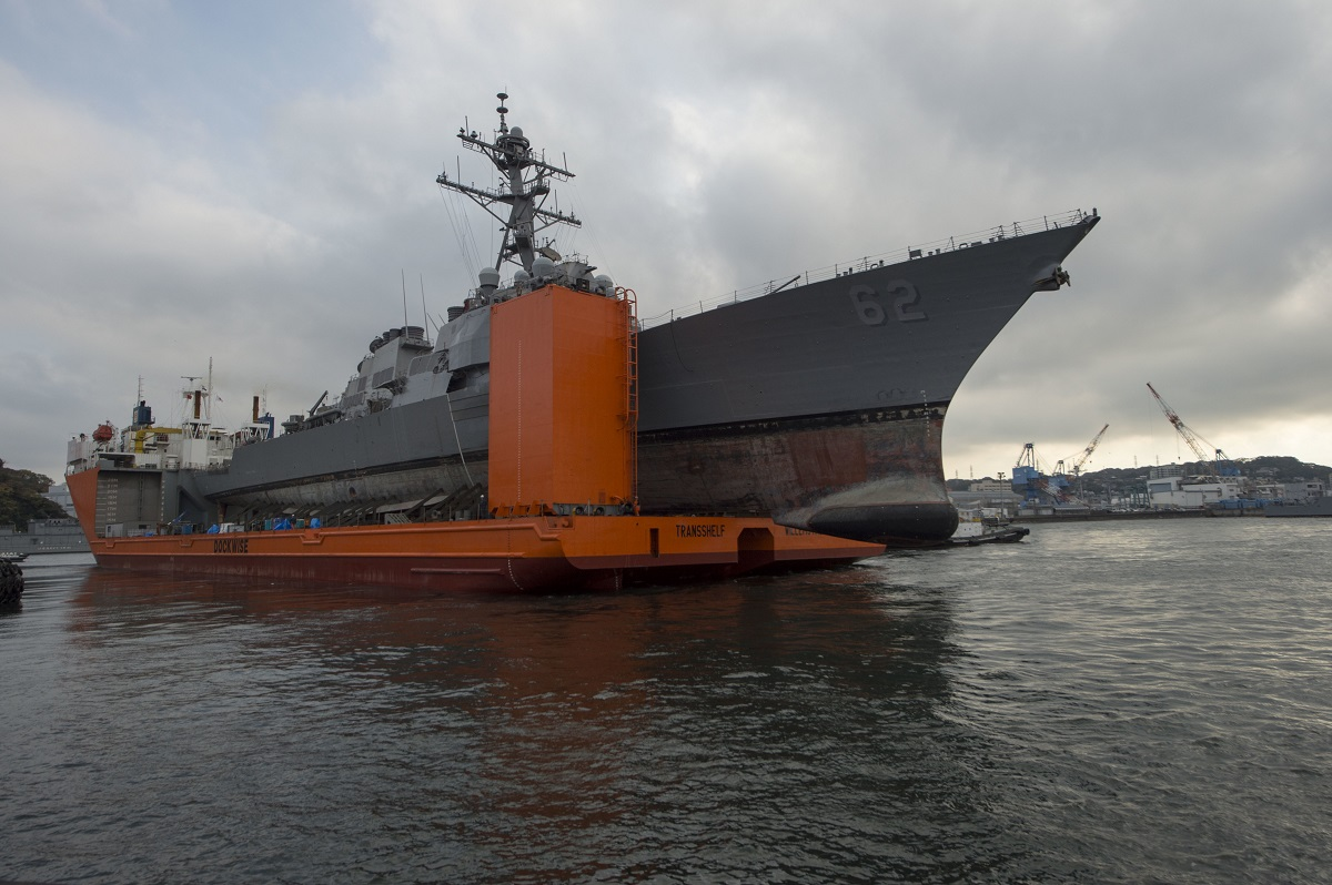 The Navy took a stunning and historic measure on Jan. 16 by charging two commanding officers with negligent homicide in the two ship collisions last summer. One of those ships, the Fitzgerald, is pictured here being transported from Japan. (MC1 Benjamin Dobbs/Navy)
