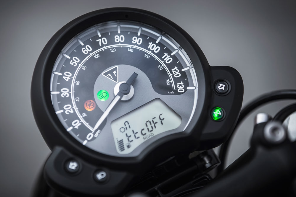 The gauge cluster itself is nice and clean, and uncluttered. You can see the green headlight beam indicator to the immediate left of the needle and the orange traction control light is lit up, notifying the rider that traction control has been turned off. You also have a handy fuel gauge, as well as a gear indicator in the top left corner. (Triumph Motorcycles)