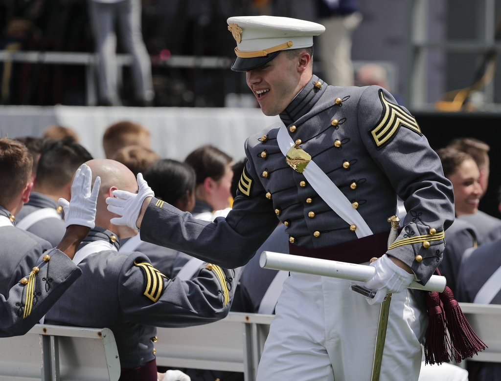 A West Point cadet gets a high five from a friend after receiving his diploma during graduation ceremonies at the United States Military Academy, Saturday, May 26, 2018, in West Point, N.Y. (Julie Jacobson/AP)