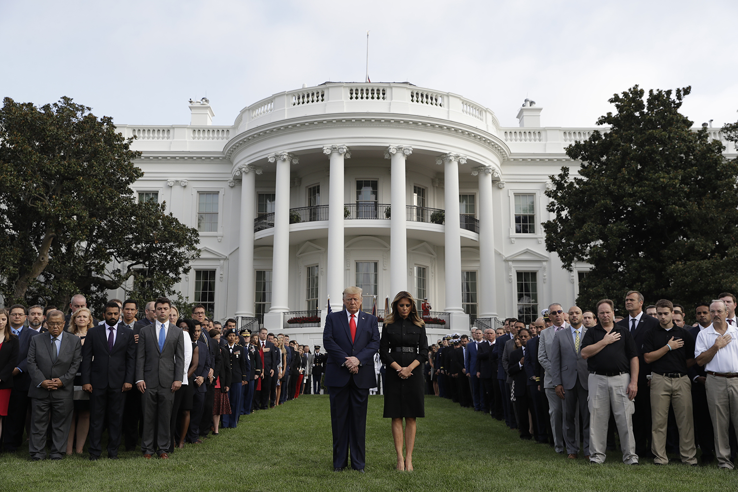 President Donald Trump and first lady Melania Trump participate in a moment of silence honoring the victims of the Sept. 11 terrorist attacks, on the South Lawn of the White House, Wednesday, Sept. 11, 2019, in Washington. (Evan Vucci/AP)