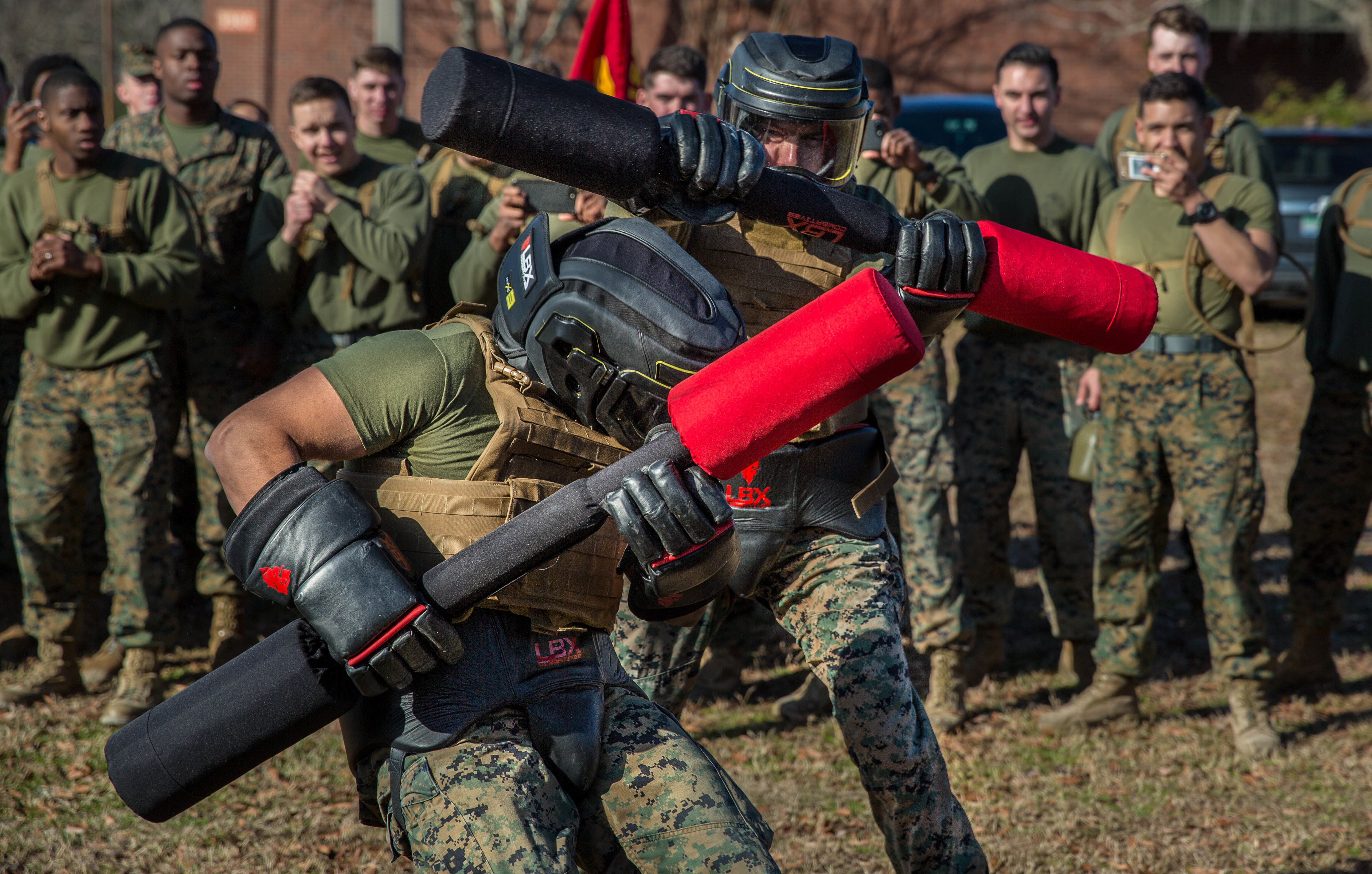U.S. Marines with Marine Wing Communication Squadron (MWCS) 28 compete in a pugil stick match during the Spartan Cup competition on Marine Corps Air Station Cherry Point, N.C., Feb. 9, 2018. The Spartan Cup is an MWCS-28 event held semiannually to give the Marines a chance to compete against one another while building camaraderie and unit cohesion. (Cpl. Jonathan Wiederhold/Marines)