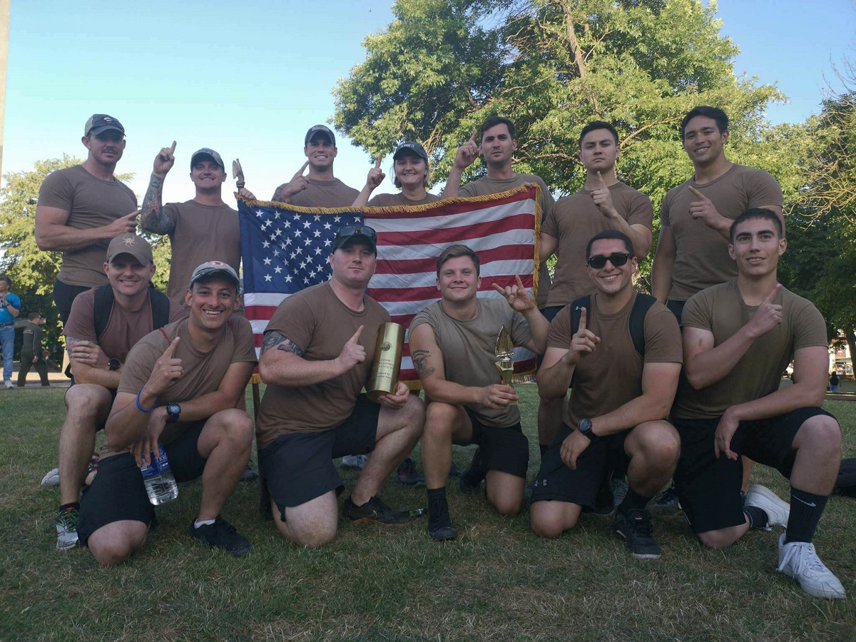 A big part of BALTOPS is focused on developing ties between allies, but sometimes, national pride still wins out. Here, U.S. sailors assigned to the Blue Ridge-class command and control ship Mount Whitney hold an American flag after winning a captain's cup sports tournament June 2 in Lithuania. (James Decker/U.S. Navy)