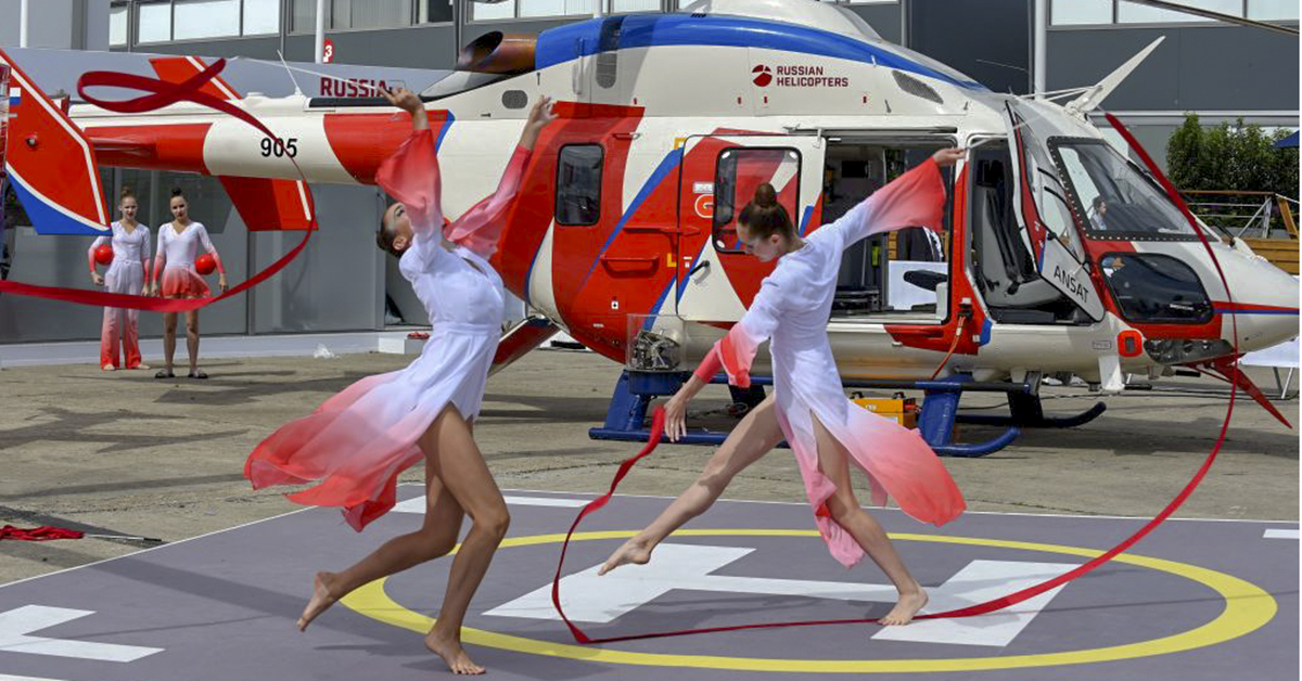 Gymnasts perform at the Russian Helicopters static display of the Ansat helo during the Paris Air Show on June 19, 2019. (Eric Piermont/AFP via Getty Images)
