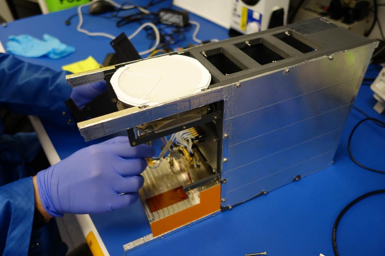A technician works on Lockheed Martin's Pony Express 1 payload. (Lockheed Martin)