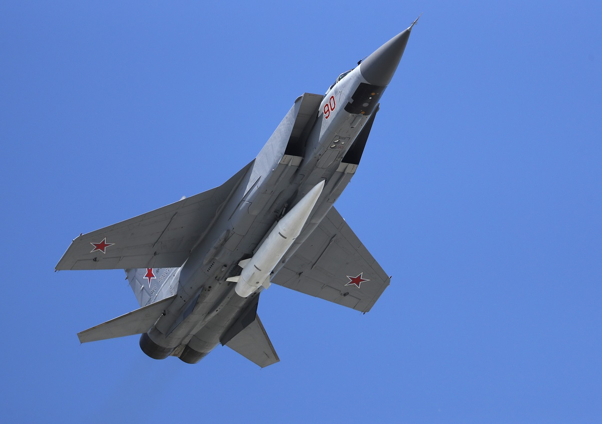 A Russian Air Force MiG-31K jet carries the high-precision hypersonic missile Kh-47M2 Kinzhal during the Victory Day military parade. (Pavel Golovkin/AP)