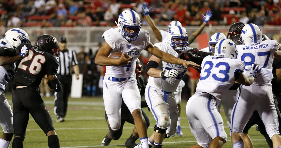 Air Force quarterback Isaiah Sanders crosses into the end zone on a quarterback keep play during the first half University of Las Vegas, Las Vegas Friday. (Steve Marcus/Las Vegas Sun via AP)
