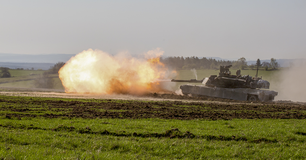 Soldiers assigned to 1st Battalion 63rd Armor Regiment, 2nd Armored Brigade Combat Team, 1st Infantry Division, conduct training with an M1A2 Abrams tank during Combined Resolve X Live Fire Exercise at Grafenwoehr, Germany, April 19, 2018. The Joint Warfighting Assessment (JWA) helps the Army evaluate emerging concepts, integrate new technologies, and promote interoperability within the Army, with other services, U.S. allies, and other coalition partners. (Spc. Genesis Gomez/Army)