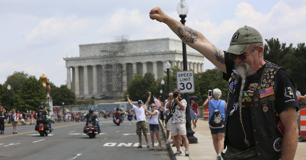 Air Force veteran Ray Weaver from Lancaster, Penn., gives his traditional salute on Sunday, May 27, to riders in the Rolling Thunder motorcycle procession on Memorial Day in Washington, D.C.(Ben Murray/Military Times)