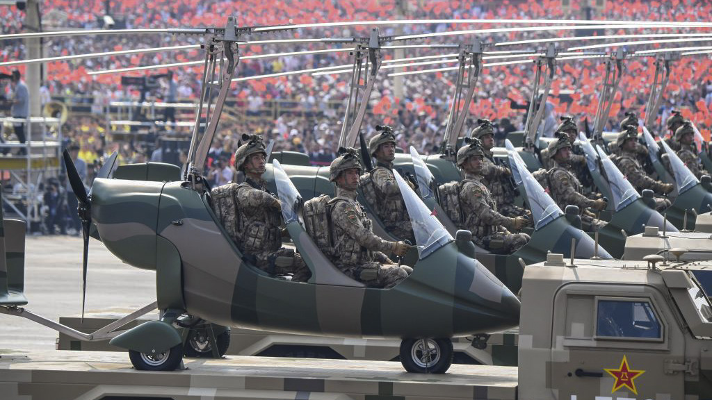 Military vehicles carrying military aircraft participate in a military parade at Tiananmen Square in Beijing on October 1, 2019, to mark the 70th anniversary of the founding of the Peoples Republic of China. (GREG BAKER/AFP/Getty Images)