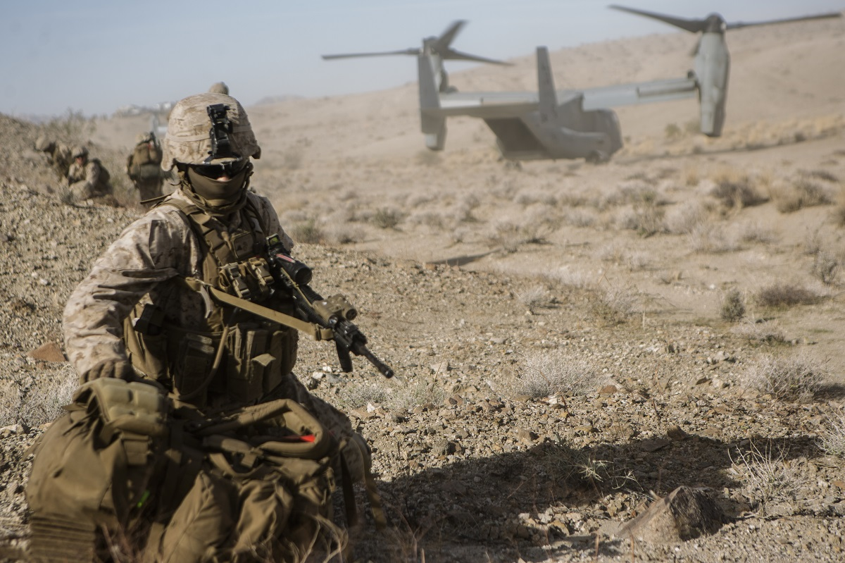 U.S. Marine Lance Cpl. James Johnson Jr., drops his load-bearing pack after extracting from an MV22 Osprey for an Air Assault Course during Integrated Training Exercise 1-19 at Twentynine Palms, Calif. (Cpl. Timothy J. Lutz/Marine Corps)