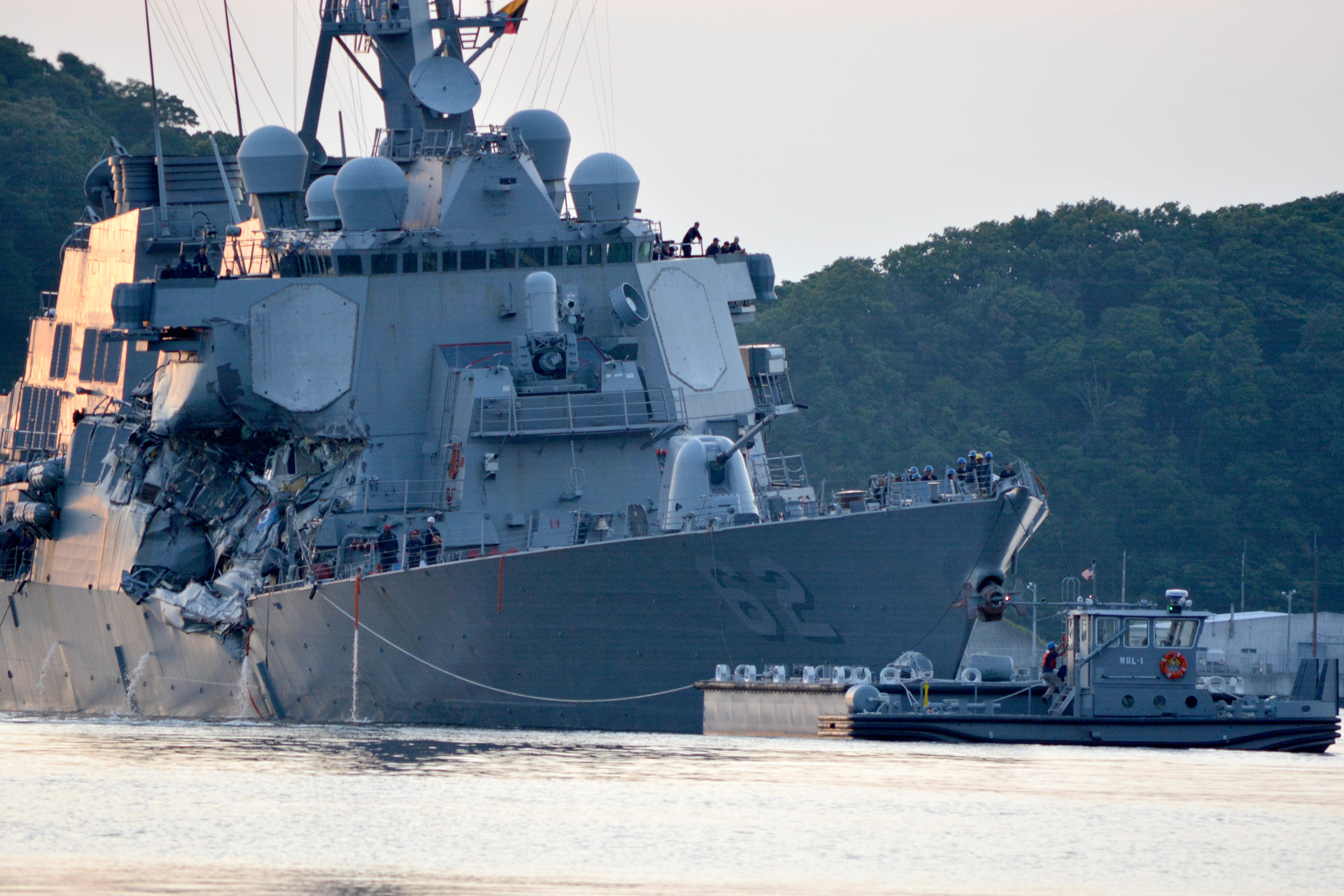 The COs of the destroyers Fitzgerald and John S. McCain will face negligent homicide charges in connection to collisions last summer that killed 17 sailors. (MC1 Peter Burghart/Navy)