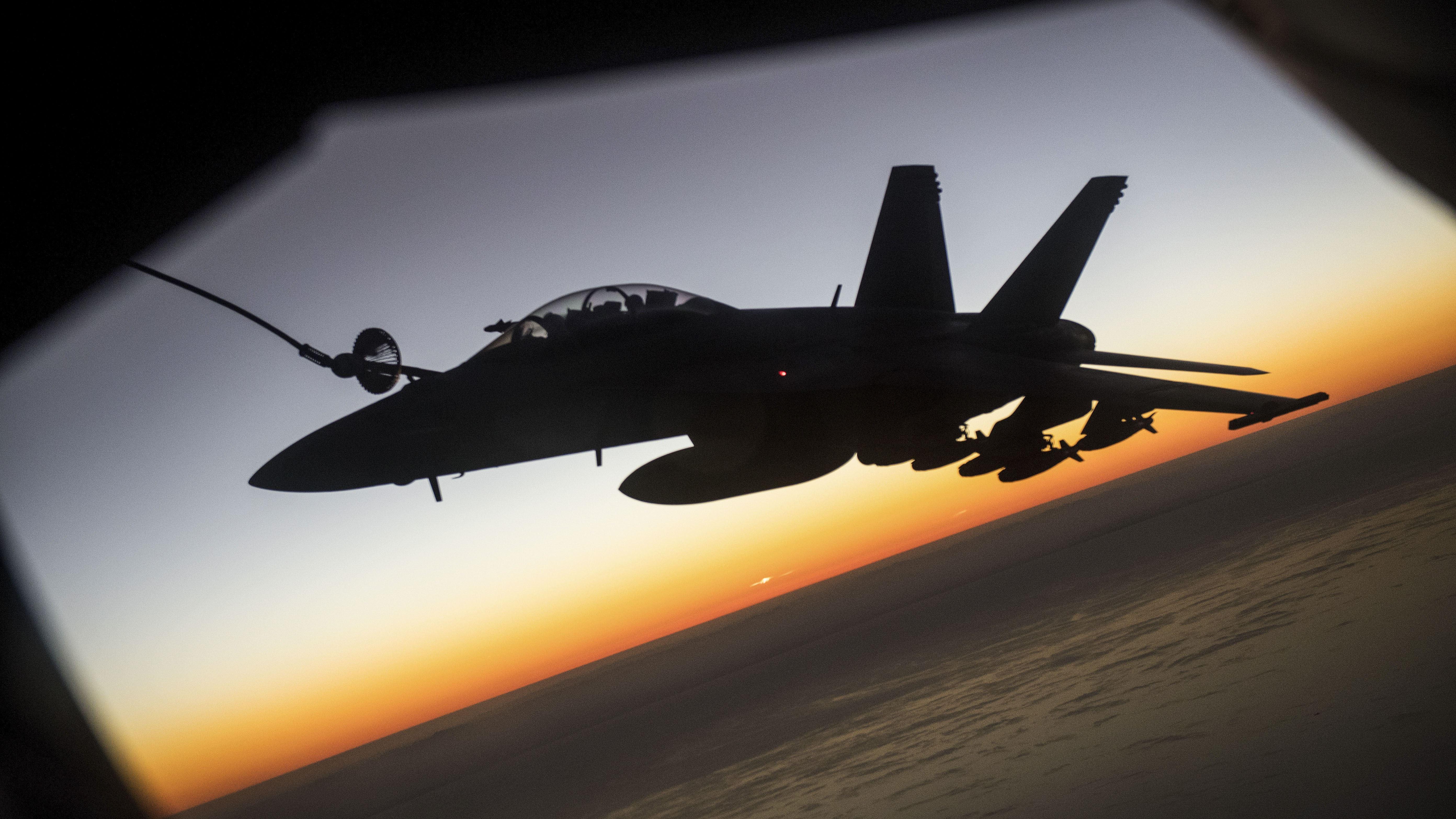A Navy Super Hornet receives fuel from an Air Force KC-135 Stratotanker over Afghanistan, Dec. 7, 2017. Navy Super Hornets conducted a series of precision airstrikes against six Taliban narcotic targets in Helmand province. Air Force photo by Jeff Parkinson