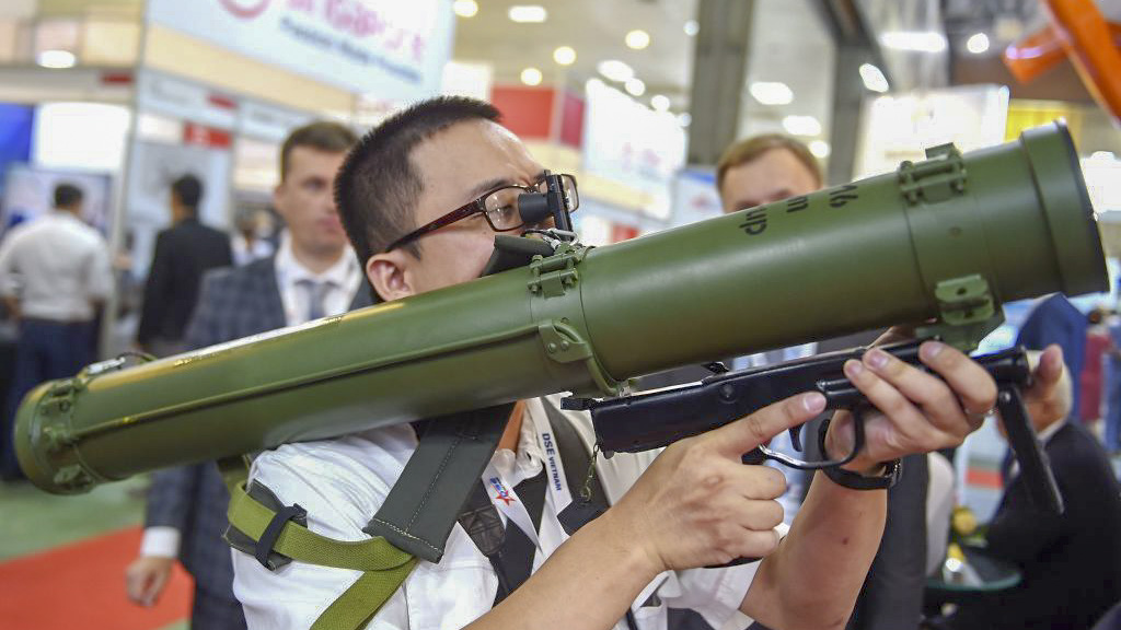A visitor holds a Ukrainian-made RPV16 thermobaric rocket launcher also known as the
