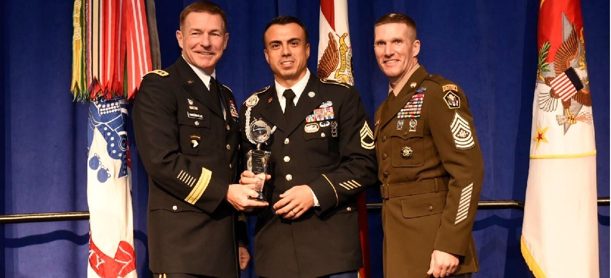 Cpl. Matthew Hagensick, center, poses with his NCO of the Year Award, alongside Army Vice Chief of Staff James McConville, left, and Sergeant Major of the Army Dan Dailey, right, on Oct. 8, 2018, at the Association of the United States Army annual meeting in Washington, D.C. (Stephen Barrett for Army Times)
