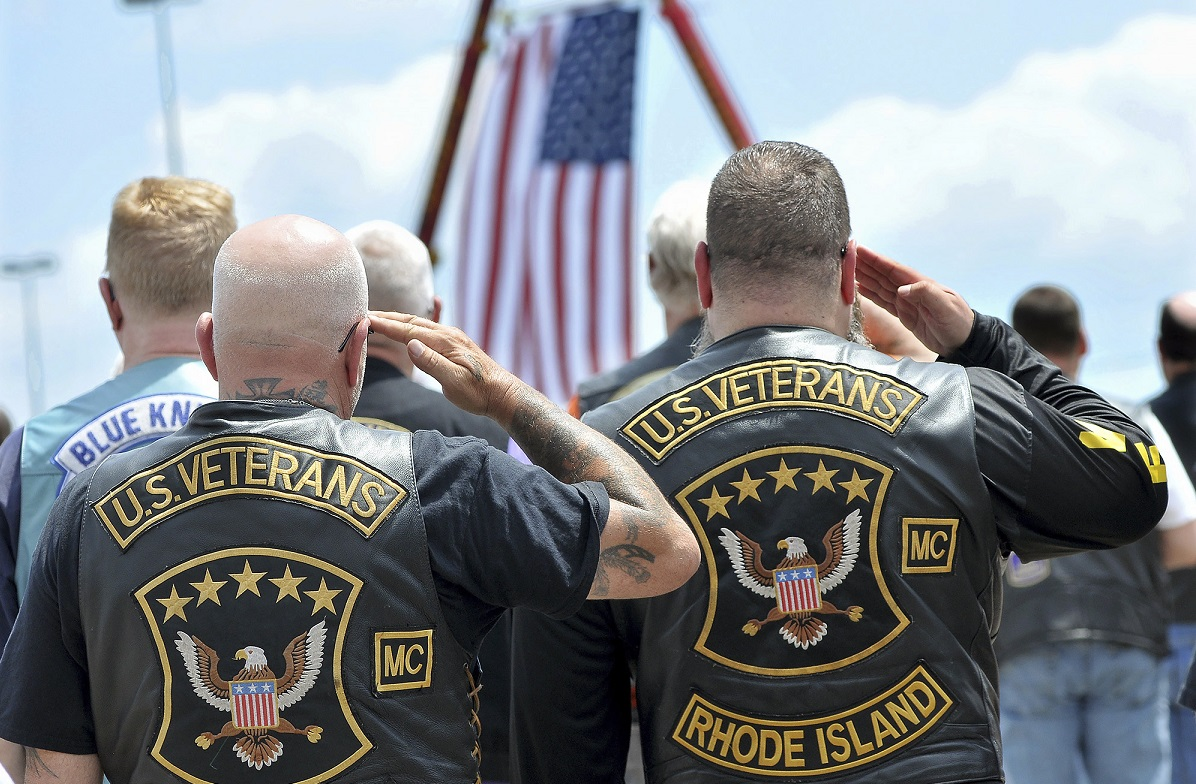 Members of the U.S. Veterans Motorcycle Club salute the flag during the playing of the National Anthem at the beginning of a memorial and remembrance service for seven motorcyclists and spouses who died in the June crash in the parking lot of Gillette Stadium in Foxboro, Massachusetts July 13. (Mark Stockwell/The Sun Chronicle via AP)