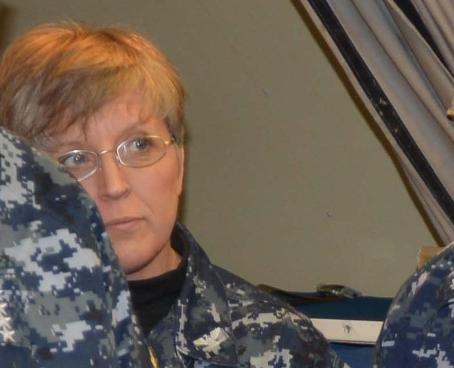 Capt. Heather Cole, then-commander of Strategic Communications Wing 1 and Task Force 124, listens in during a 2014 briefing at Tinker Air Force Base. (Navy)