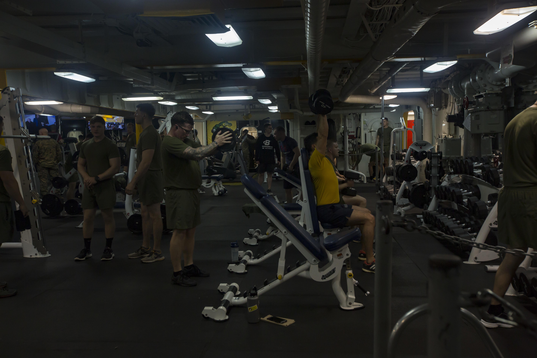 Marines and Sailors utilize the gym at sea, Feb. 4, 2018. (Lance Cpl. Jasmine Price, Marine Corps)