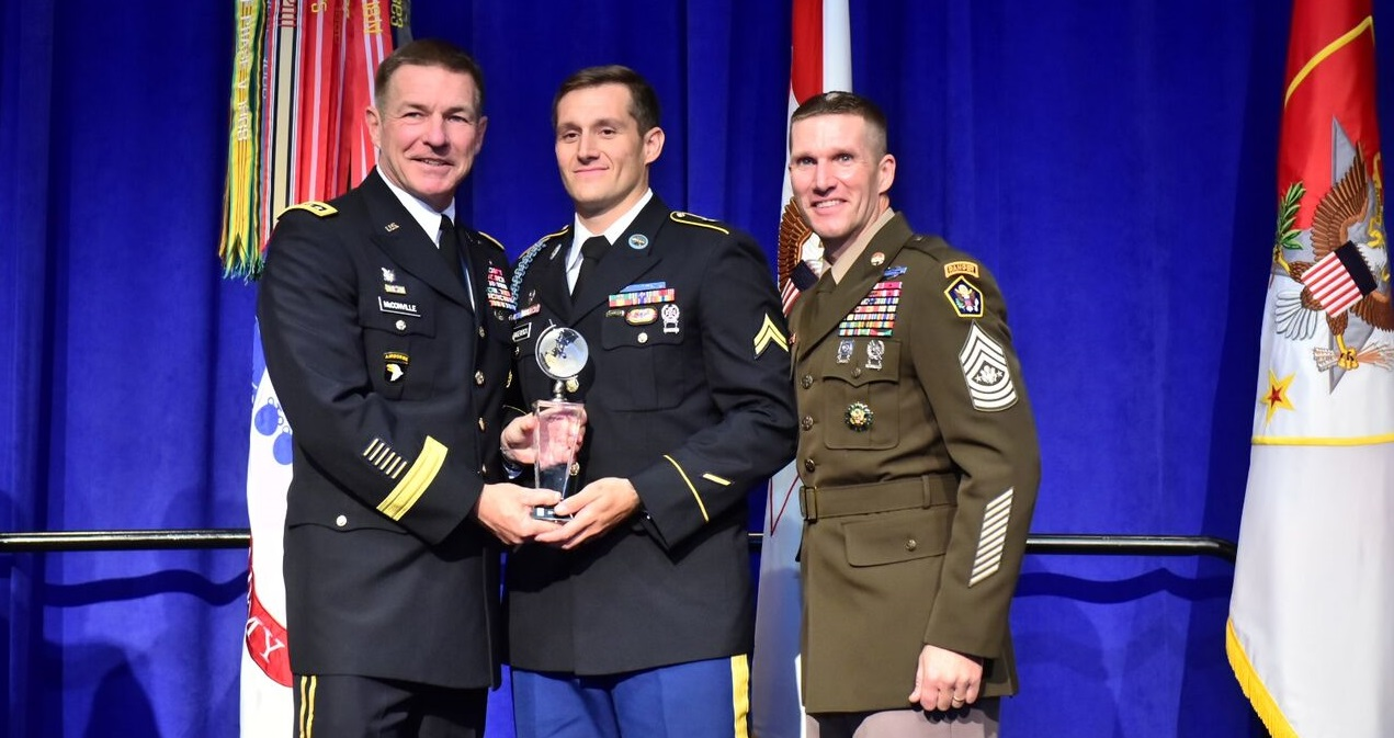 Cpl. Matthew Hagensick, center, poses with his Soldier of the Year Award, alongside Army Vice Chief of Staff James McConville, left, and Sergeant Major of the Army Dan Dailey, right, on Oct. 8, 2018, at the Association of the United States Army annual meeting in Washington, D.C. (Stephen Barrett for Army Times)