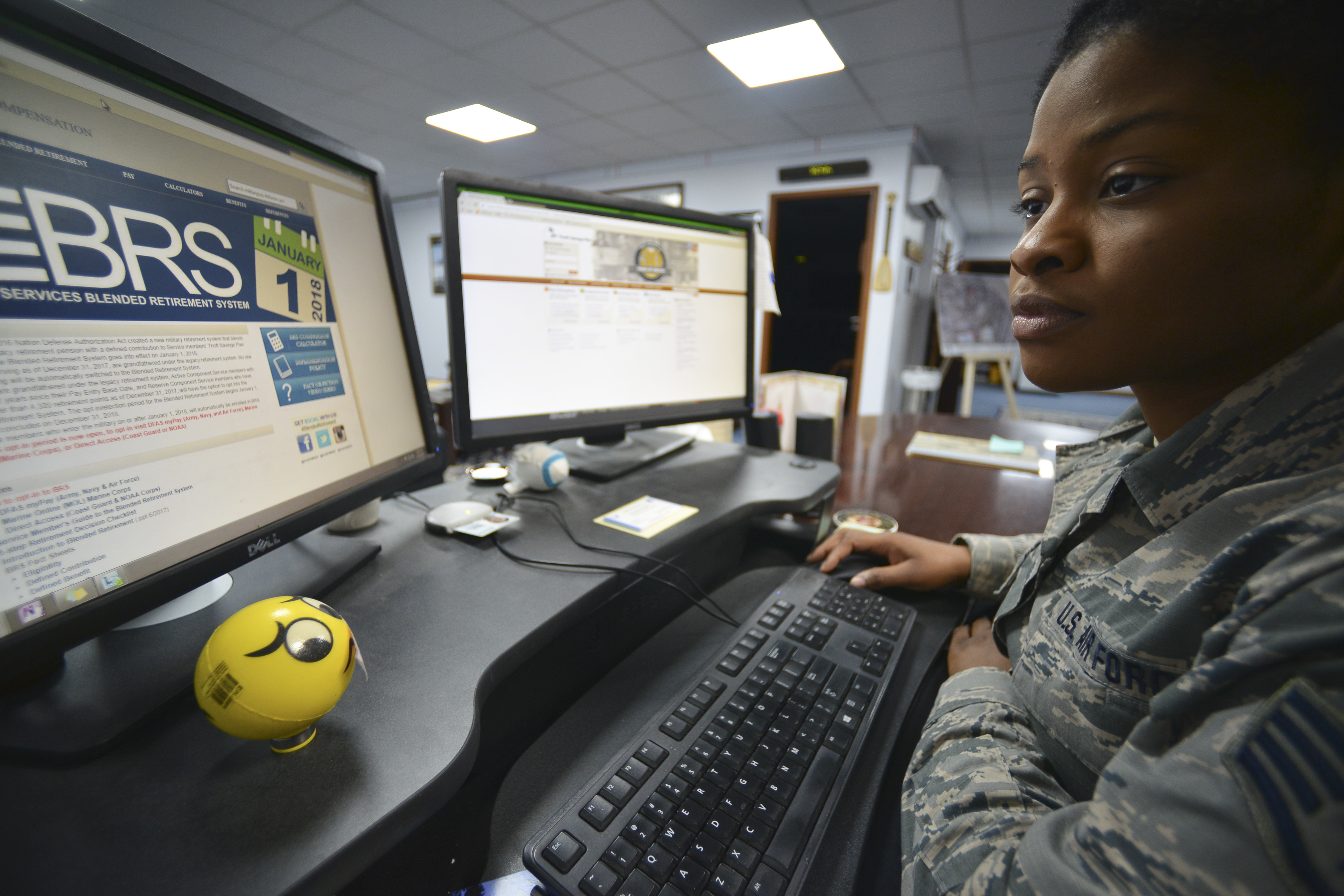 About 1.6 million service members have a choice to make this year, between the legacy retirement system and the new Blended Retirement System. Here, Air Force Staff Sgt. Dalia Theodule, 380th Air Expeditionary Wing command chief executive assistant, researches the Blended Retirement System on Al Dhafra Air Base, United Arab Emirates. (Airman 1st Class D. Blake Browning/Air Force)