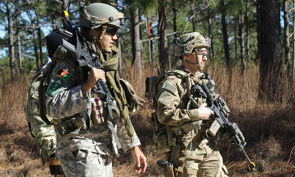 Capt. Justin Alexander, a combat adviser team leader, walks with an Afghan National Defense Security Forces role player during training at the Joint Readiness Training Center in Fort Polk, La., Jan. 13. (Pfc. Zoe Garbarino/Army)