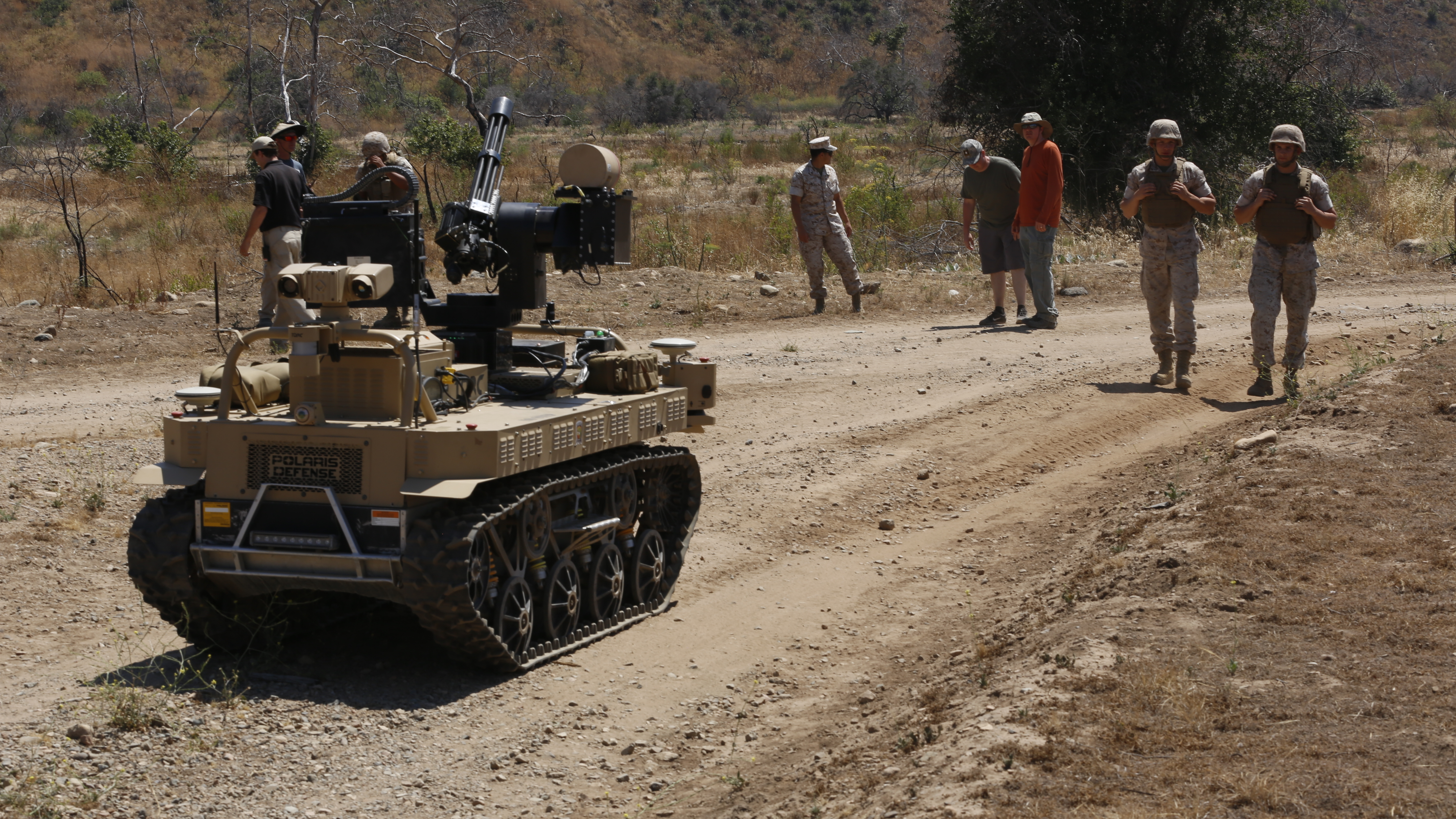 Marines with Kilo Company, 3rd Battalion, 5th Regiment, execute a patrol exercise with the robotic vehicle modular aboard Camp Pendleton, Calif., June 23, 2016. The system is still in development and will be used during exercise Rim of the Pacific. The Marine Corps Warfighting Laboratory is conducting a Marine Air-Ground Task Force Integrated Experiment to explore new gear and access its capabilities for potential future use. (U.S. Marine Corps photo by Lance Cpl. Frank Cordoba/Released)