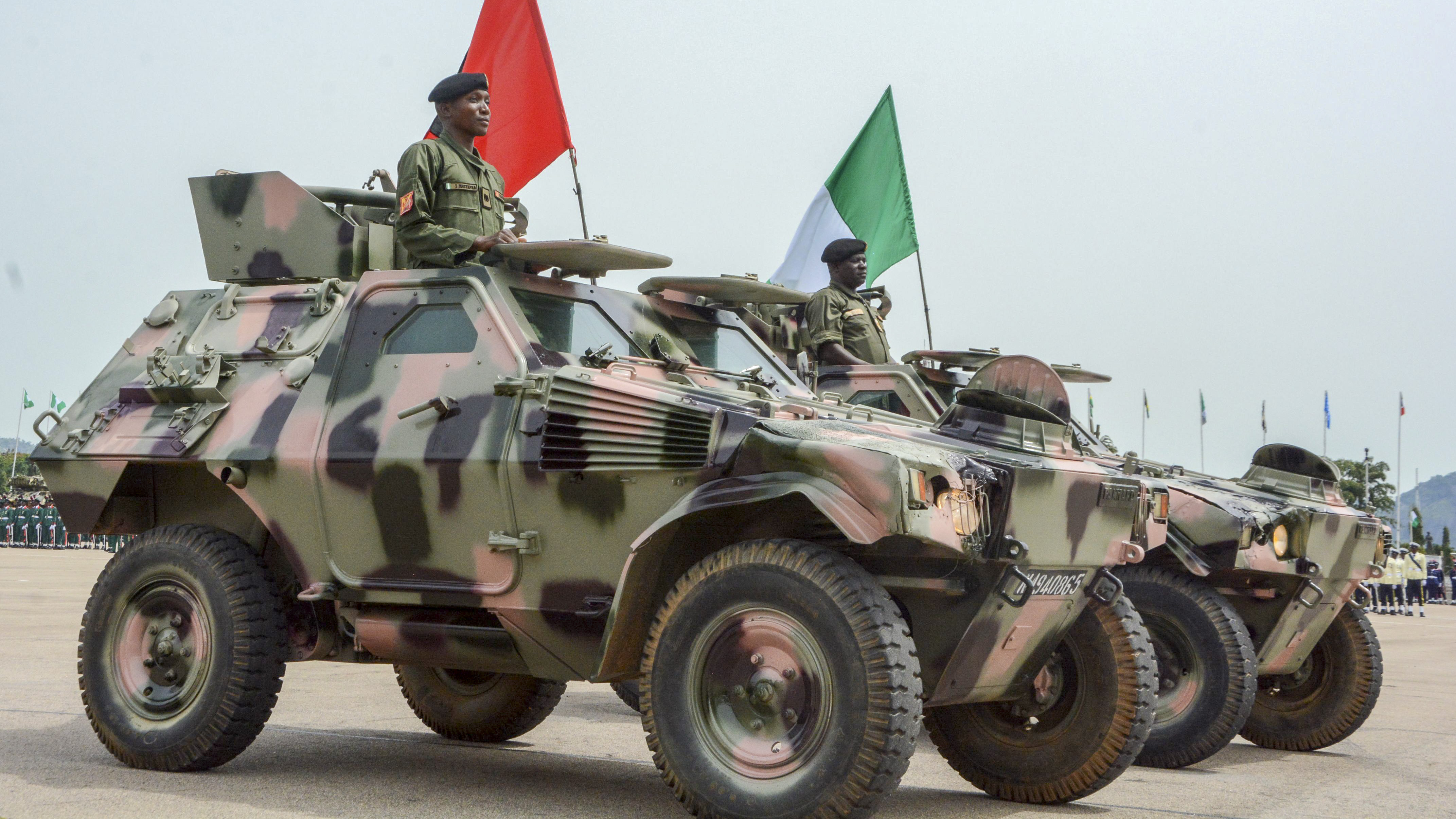 Nigerian soldiers stand on armoured vehicles during a parade marking the country's 58th anniversary of independence, on October 1, 2018, on Eagle Square in Abuja. (SODIQ ADELAKUN/AFP/Getty Images)